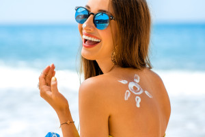 Using sunscreen with a spray tan